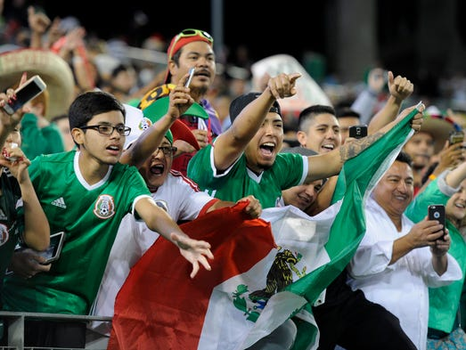 Mexican fans celebrate their team's 2-1 victory over