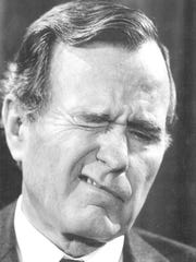 Then-Vice President George H.W. Bush speaks with a