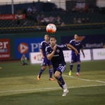 LouCity midfielder Andrew Lubahn chases down a ball in the second half of a game against FC Montreal on July 4, 2016.
