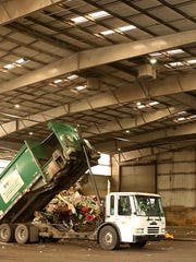 A Waste Management truck dumps it's load at the Olympic View Transfer Station.