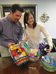 In this file photo, CASA volunteers Shane and Stephanie Smith look over the Easter baskets to be given to the children in their Court Appointed Child Advocates case. The Smiths help look out for the child's best interests as they make their way through the courts in Child Protective Services cases.