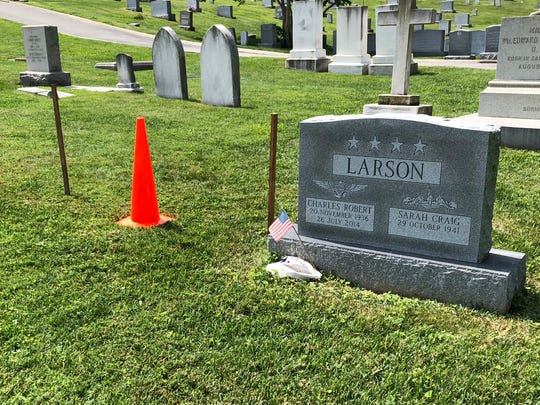 Sen. John McCain's burial plot is marked with two wooden stakes and an orange cone at the U.S. Naval Academy Cemetery in Annapolis, Md. He will be buried next to his old friend, and academy classmate, Chuck Larson.