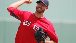 Boston starter Rick Porcello (22) delivers. (AP Photo/Brynn Anderson)