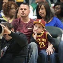 Chris Sharett of Indianapolis and his six-year-old son Brady Sharett sat in disappointment after it was announced an hour before the game that Cleveland Cavalier superstar LeBron James wasn't going to play against the Pacers at Bankers Life Fieldhouse on Friday, Feb. 27, 2015.
