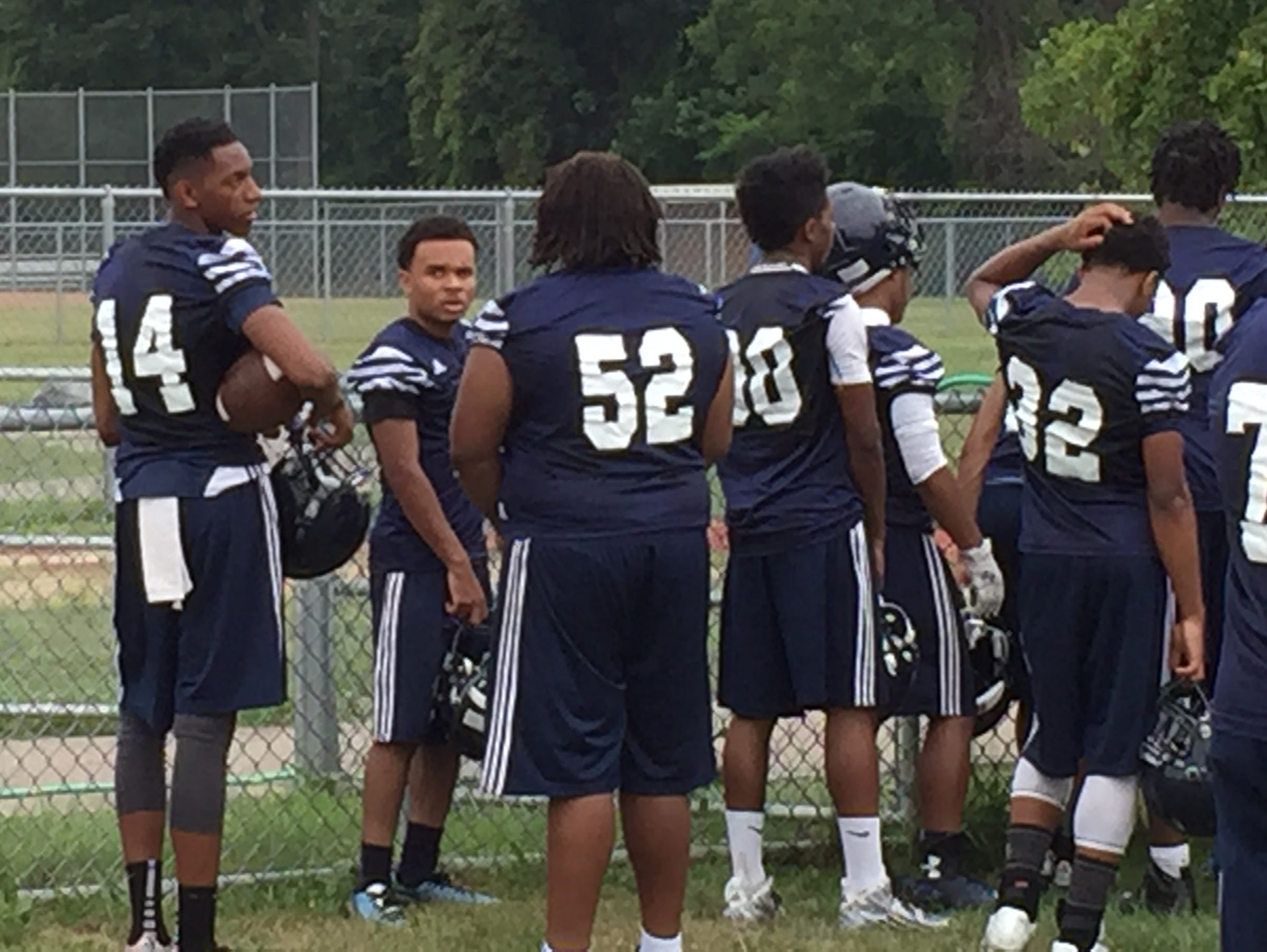 Southfield quarterback Sam Johnson III (#14) with his teammates at practice Aug. 10, 2015.
