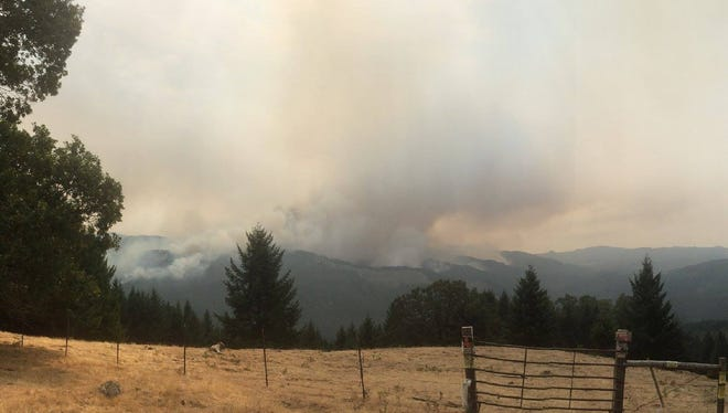 Smoke rises from the Chetco Bar Fire in southwestern Oregon Monday, Sept. 4.