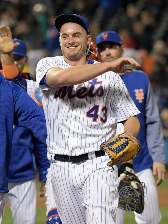 New York Mets relief pitcher Addison Reed celebrates after closing a baseball game as the Mets defeated the Los Angeles Angels, Saturday, May 20, 2017 at Citi Field in New York. (AP Photo/Bill Kostroun)