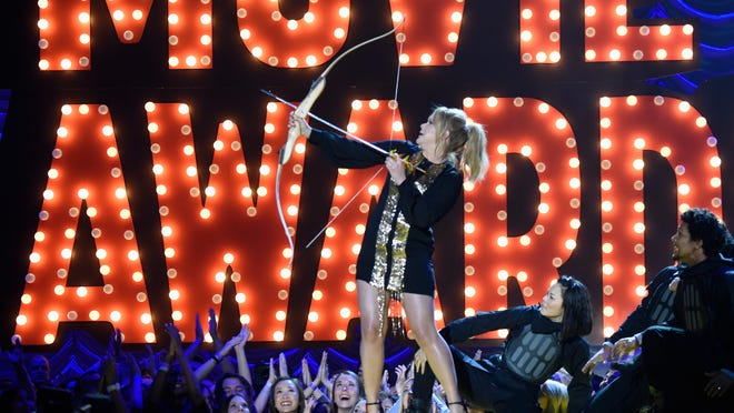 LOS ANGELES, CA - APRIL 12:  Host Amy Schumer onstage during The 2015 MTV Movie Awards at Nokia Theatre L.A. Live on April 12, 2015 in Los Angeles, California.  (Photo by Kevin Mazur/MTV1415/WireImage) ORG XMIT: 547574747 ORIG FILE ID: 469518354