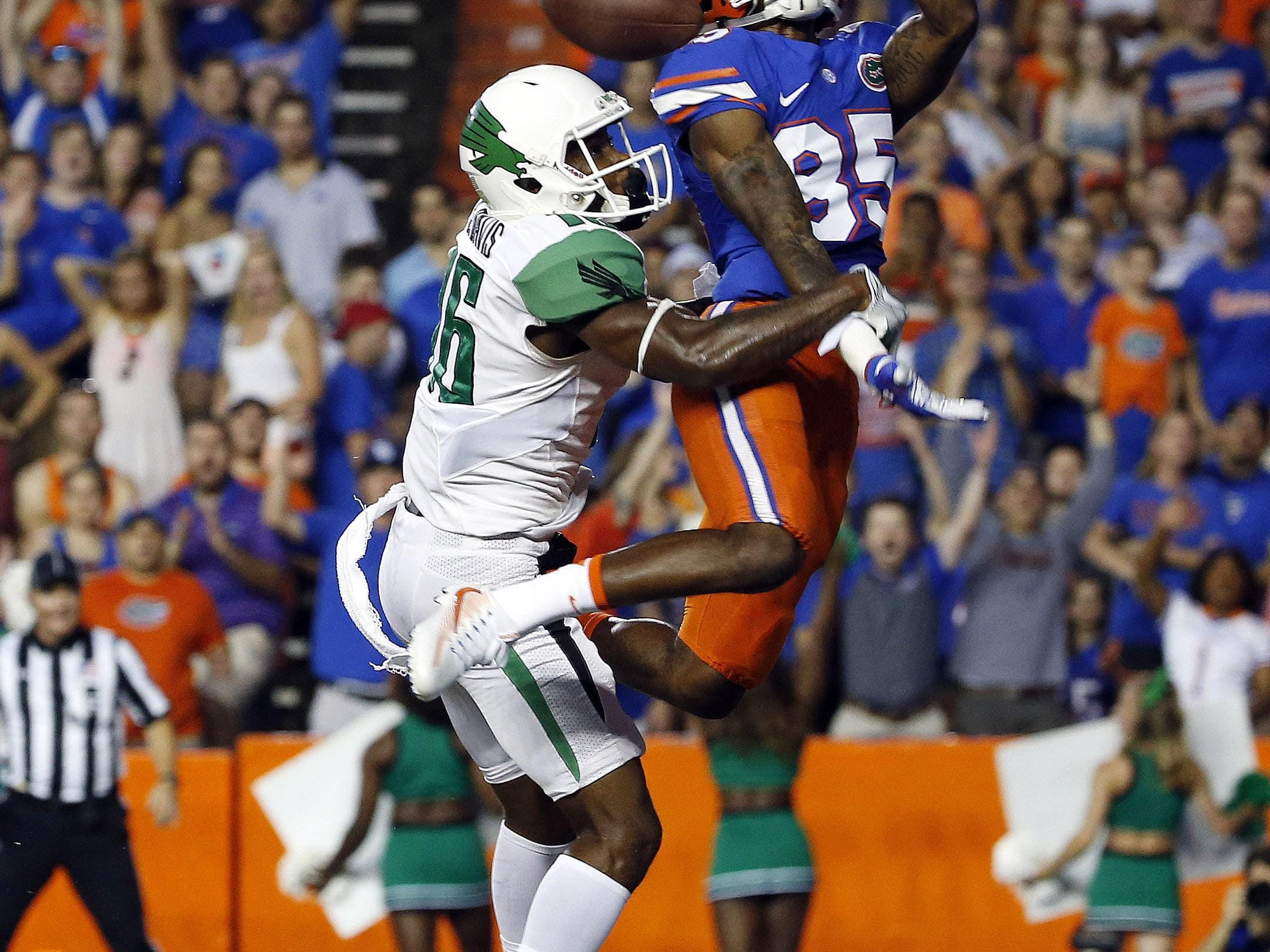 North Texas defensive back Chad Davis is called for pass interference against Florida wide receiver Chris Thompson on Saturday.