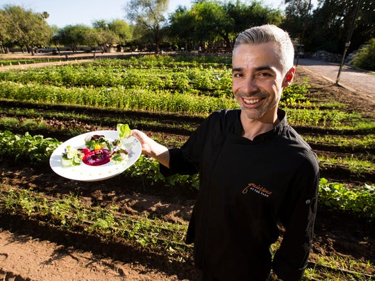 Executive Chef Dustin Christofolo with his salad, Farmers Foraged, made from the greens and vegetables growing on his farm on Oct. 25, 2017, at Quiessence at The Farm at South Mountain in Phoenix.