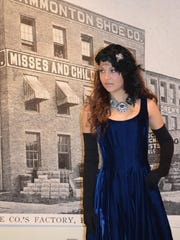 "Isabella Mortellite of Hammonton models jewelry made by April Schenk of Hammonton during the opening reception of the Noyes Gallery Exhibition, ""Hammonton: 150 Years of Industry"" at Kramer Hall, 30 Front St., during Third Thursday."