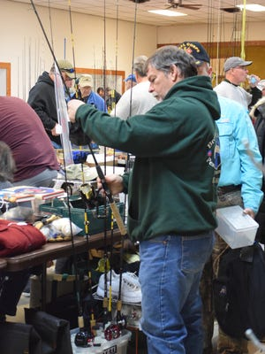 Carl Camp of Port Elizabeth looks at a fishing pole at last year's South Jersey Bass Club Association's annual Fishermen's Flea Market.