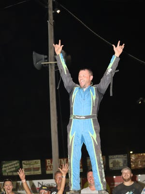 Fremont's Jamie Miller celebrates an historic Saturday at Fremont Speedway. He took three division features (305, dirt truck, late model).