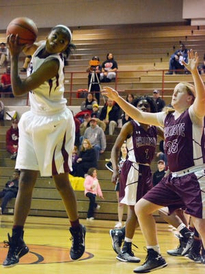 Pineville's Krystal Freeman (left) catches a pass in the post Thursday night during the Lady Rebels' easy win over Chalmette in the first round of the 2015 Class 5A girls basketball playoffs.