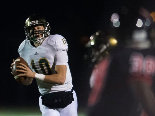 Catholic's Jack Sompayrac (10) looks for a pass during a 5A semifinals game between Knoxville Catholic and Central at Central High School in Knoxville, Tenn., Friday, Nov. 24, 2017.