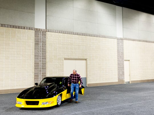 Ronnie Cooper steps out of his custom Corvette Split Window Coupe based on the 1963 model during set up for the annual Knox News Auto Show at the Knoxville Convention Center in Knoxville, Tennessee on Thursday, February 22, 2018. The show runs from February 23-25 and features over 250 cars from dozens of manufacturers.