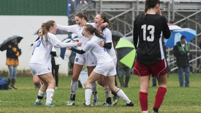 Colchester celebrates a goal by Brenna McMannon, second from left, during the girls soccer game against Champlain Valley at Colchester High School on Saturday morning.