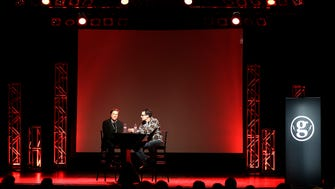 Jeff Rusinow (left), an active and early member of the venture capital community, is interviewed by Jon Eckhardt, a University of Wisconsin-Madison professor of entrepreneurship, during the gener8tor Milwaukee 2014 Premiere Night  on Oct. 22, 2014.