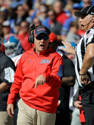 Mississippi football coach Hugh Freeze, left, argues a call against Memphis on Oct. 17, 2015.
