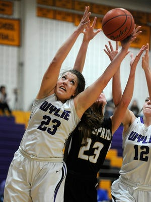 Wylie's Gabby Zullo (left) pulls down a rebound over Big Spring's Logan Terrazas (center) during the third quarter of the Lady Bulldogs' 62-25 win on Tuesday, Jan. 10, 2017, at Wylie High School.