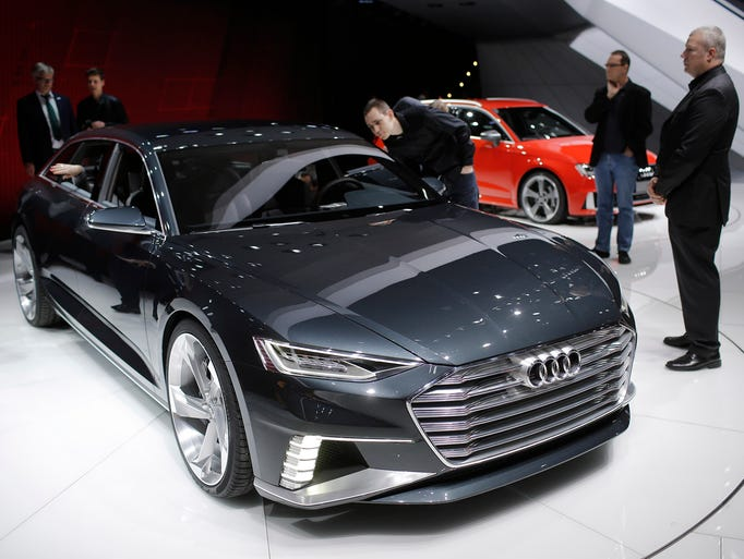 The new Audi A9 Prologue is surrounded by journalists