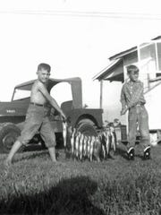 Robert Ballard, left, after a day of family fishing in 1955.