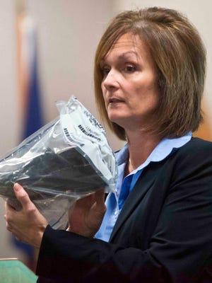 Prosecutor Lisa Warren shows jury Jenkins' shoe found at scene of her abduction.