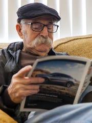 George Convery reads a magazine at the Cedar City senior citizen center, Wednesday, Feb. 10, 2016.