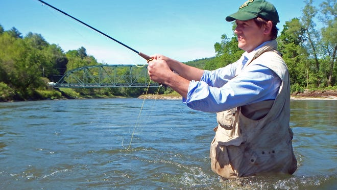 Vermont Fish and Wildlife Commissioner Louis Porter casts a fly in 2014 while fishing the trophy trout section of the Winooski River in Waterbury.