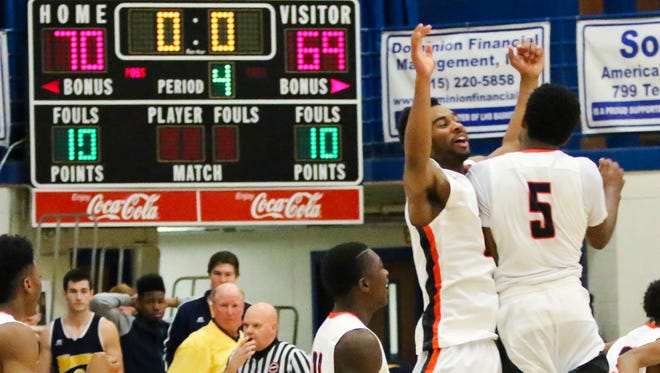 Blackman's Jarrell Reeves and Jaellen White (5) celebrate Blackman's win over Nashville Central Christian on Saturday.