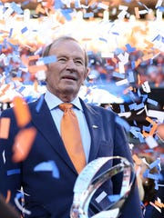 Jan 19, 2014; Denver, CO, USA; Denver Broncos owner Pat Bowlen with the Lamar Hunt trophy after the 2013 AFC Championship game at Sports Authority Field against the New England Patriots at Mile High. Mandatory Credit: Matthew Emmons-USA TODAY Sports