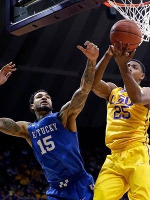 Kentucky forward Willie Cauley-Stein (15) battles under the basket for a rebound with LSU forward Jordan Mickey (25) in the first half of an NCAA college basketball game in Baton Rouge, La., Tuesday, Feb. 10, 2015. (AP Photo/Gerald Herbert)