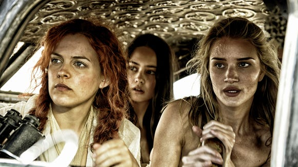 (L to R) Riley Keough, Courtney Eaton, and Rosie Huntington-Whiteley