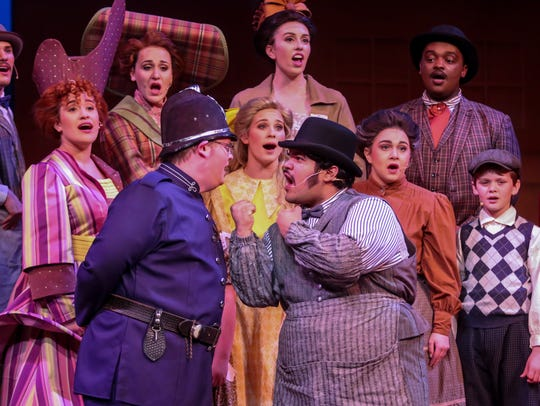 """Cast members rehearse scenes from """"The Music Man"""" on"""