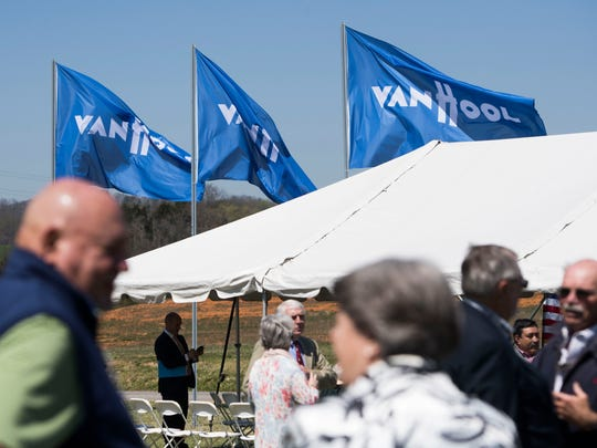 Van Hool flags fly before the announcement of the Belgian bus company building a factory in Morristown, Tenn. and creating more than 600 jobs, Thursday, April 12, 2018.