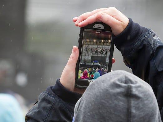 A fan takes video of Salt-n-Pepa during Mixtape Festival