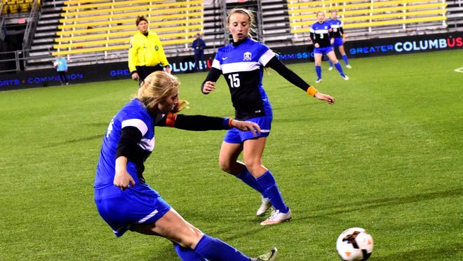Laurin Uptegrove (front-14) gets off a shot on goal for Springboro in the closing moments of the state championship game.