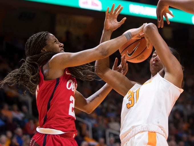 Ole Miss guard Madinah Muhammad (20) and Tennessee
