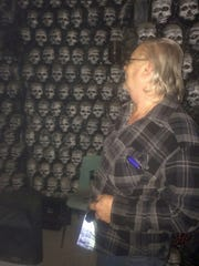 General manager George Bastien looks at a wall of skulls at the entrance to The Morgue haunted house in the Town of Oneida on Wednesday, Oct. 26, 2016.