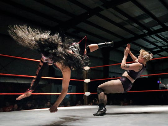 New Era Wrestler Delilah scores a flying kick to the face of Allie Kat, an Austin-based luchadora during Friday's match.