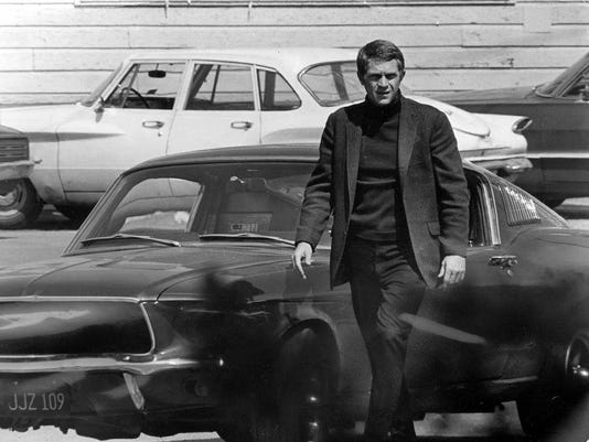 Steve McQueen and his Ford Mustang in 'Bullitt'
