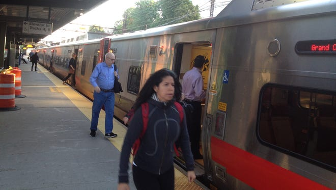 Passengers board a Manhattan-bound Metro-North train at New Rochelle on Friday morning.