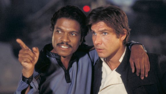 Old friends Lando Calrissian (Billy Dee Williams) and
