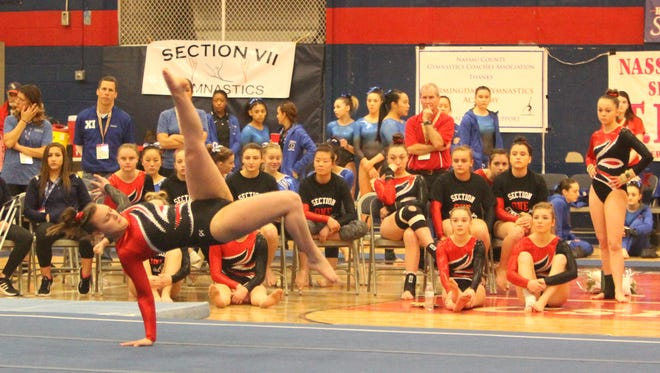 Lakeland/Panas' Amanda Grigas performs her floor exercise routine with her Section 1 teammates watching during the state gymnastics championships at Cold Spring Harbor High School on Saturday, March 5th, 2017.
