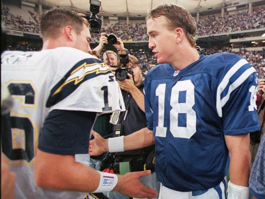 Indianapolis Colts quarterback Peyton Manning, right, meets with San Diego Chargers quarterback Ryan Leaf after the Colts defeated the Charges 17-12 in Oct. 4, 1998.
