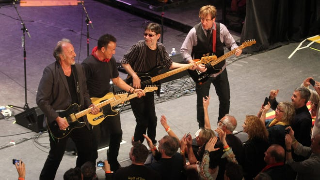 Bruce Springsteen and Joe Grushecky and the Houserockers perform with The Light of Day Festival in 2014 at the Paramount Theatre in Asbury Park.