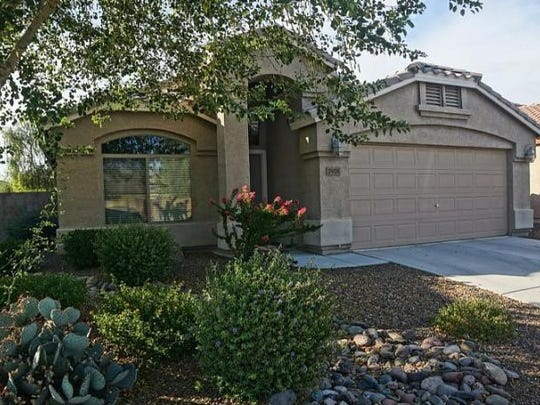 Three bedrooms, two bathrooms, one story, tile and carpet flooring, recessed lighting, kitchen island, upgraded cherry cabinets, granite kitchen counters, stainless-steel appliances, epoxy garage floor, office, backs to natural desert.