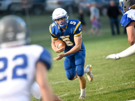 Northern Lebanon Viking Stephen Herb looks for an opening in the Cedar Crest match up Friday night, September 8.