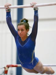 Suffern's Callie Drab competes on the uneven bars during