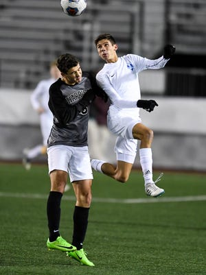 Harrison's Justin Rowe (3) and Castle's Simon Paez (21) try to control the ball with a header as the Castle Knights play the Harrison Raiders in the Class 3A Boys Indiana High School Athletic Association Soccer State Finals at Michael A. Carroll Stadium in Indianapolis Saturday, October 28, 2017.